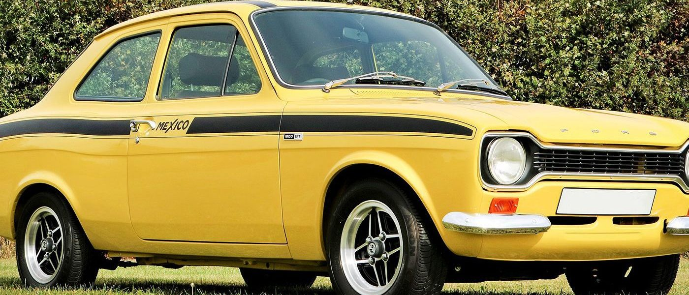 Yellow classic Ford Escort Mexico